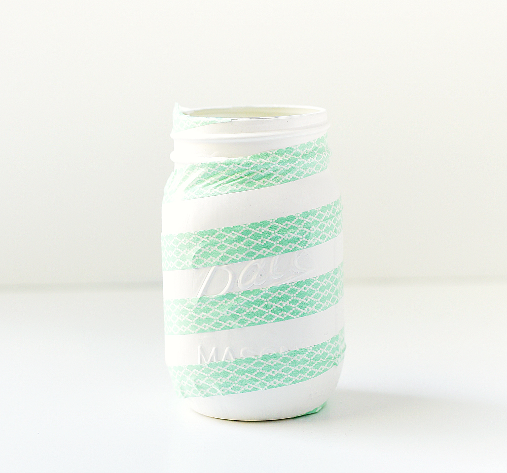 Washi Tape on Mason Jars to Make Candy Cane Mason jars