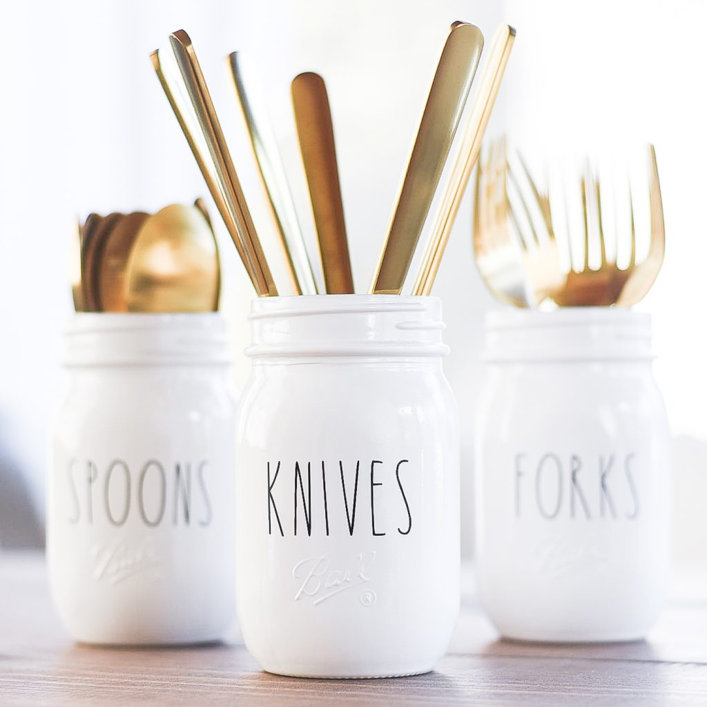 Rae Dunn-inspired mason jar utensil holders. Rae Dunn vinyl lettering on Etsy. Custom Rae Dunn vinyl. Mason jar crafts. Utensil holder ideas with jars.